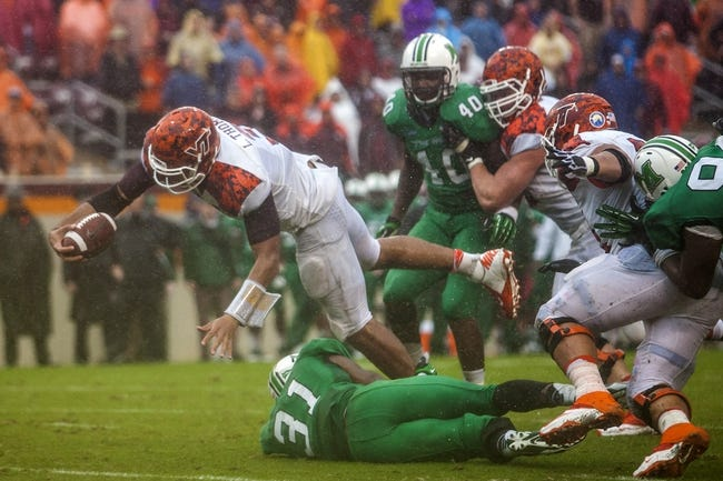 Sep 21, 2013; Blacksburg, VA, USA; Virginia Tech Hokies quarterback Logan Thomas (3) dives for the two point conversion during overtime against the Marshall Thundering Herd at Lane Stadium. Mandatory Credit: Peter Casey-USA TODAY Sports