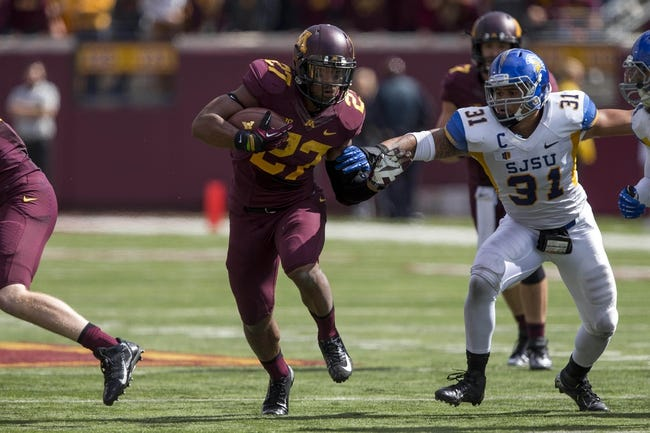 Sep 21, 2013; Minneapolis, MN, USA; Minnesota Golden Gophers running back David Cobb (27) runs the ball in the second half against the San Jose State Spartans at TCF Bank Stadium. The Gophers won 43-24. Mandatory Credit: Jesse Johnson-USA TODAY Sports