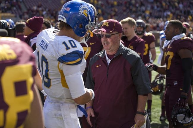 Sep 21, 2013; Minneapolis, MN, USA; San Jose State Spartans quarterback David Fales (10) and Minnesota Golden Gophers head coach Jerry Kill talk after the game at TCF Bank Stadium. The Gophers won 43-24. Mandatory Credit: Jesse Johnson-USA TODAY Sports