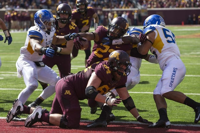 Sep 21, 2013; Minneapolis, MN, USA; Minnesota Golden Gophers running back David Cobb (27) rushes for a touchdown in the second half against the San Jose State Spartans at TCF Bank Stadium. The Gophers won 43-24. Mandatory Credit: Jesse Johnson-USA TODAY Sports