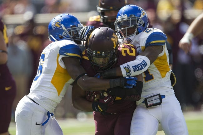 Sep 21, 2013; Minneapolis, MN, USA; Minnesota Golden Gophers running back David Cobb (27) gets tackled by San Jose State Spartans safety Damon Ogburn (6) and San Jose State Spartans cornerback Bene Benwikere (21) in the second half at TCF Bank Stadium. The Gophers won 43-24. Mandatory Credit: Jesse Johnson-USA TODAY Sports