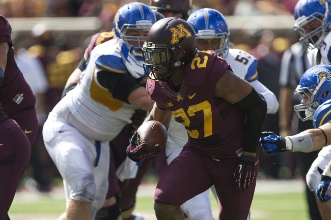 Sep 21, 2013; Minneapolis, MN, USA; Minnesota Golden Gophers running back David Cobb (27) rushes with the ball in the second half against the San Jose State Spartans at TCF Bank Stadium. The Gophers won 43-24. Mandatory Credit: Jesse Johnson-USA TODAY Sports