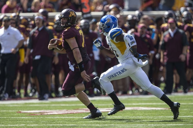 Sep 21, 2013; Minneapolis, MN, USA; Minnesota Golden Gophers quarterback Mitch Leidner (7) runs with the ball past San Jose State Spartans cornerback Bene Benwikere (21) in the second half at TCF Bank Stadium. The Gophers won 43-24. Mandatory Credit: Jesse Johnson-USA TODAY Sports