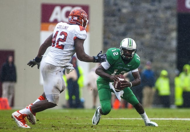 Sep 21, 2013; Blacksburg, VA, USA; Marshall Thundering Herd quarterback Rakeem Cato (12) runs the ball against Marshall Thundering Herd quarterback Rakeem Cato (12) during the second half at Lane Stadium. Mandatory Credit: Peter Casey-USA TODAY Sports