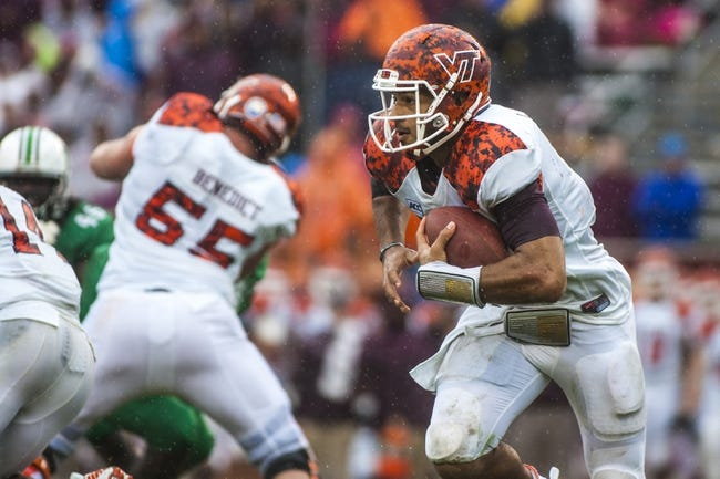 Sep 21, 2013; Blacksburg, VA, USA; Virginia Tech Hokies quarterback Logan Thomas (3) runs the ball against the Marshall Thundering Herd during the second half at Lane Stadium. Mandatory Credit: Peter Casey-USA TODAY Sports