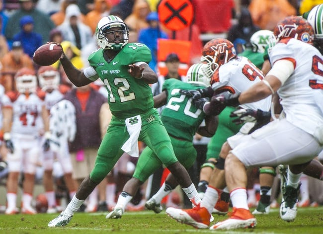 Sep 21, 2013; Blacksburg, VA, USA; Marshall Thundering Herd quarterback Rakeem Cato (12) throws a pass during the second half against the Virginia Tech Hokies at Lane Stadium. Mandatory Credit: Peter Casey-USA TODAY Sports