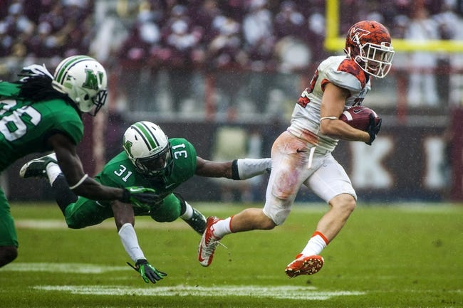 Sep 21, 2013; Blacksburg, VA, USA; Virginia Tech Hokies wide receiver Willie Byrn (82) runs the ball against Marshall Thundering Herd linebacker Evan McKelvey (31) during the second half at Lane Stadium. Mandatory Credit: Peter Casey-USA TODAY Sports