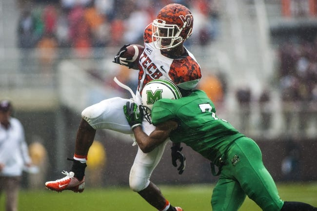 Sep 21, 2013; Blacksburg, VA, USA; Virginia Tech Hokies wide receiver Demitri Knowles (80) is tackled by Marshall Thundering Herd defensive back Darryl Roberts (7) during the second half at Lane Stadium. Mandatory Credit: Peter Casey-USA TODAY Sports