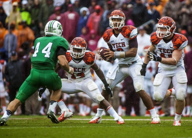 Sep 21, 2013; Blacksburg, VA, USA; Virginia Tech Hokies quarterback Logan Thomas (3) drops back to pass against the Marshall Thundering Herd at Lane Stadium. Mandatory Credit: Peter Casey-USA TODAY Sports