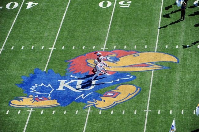 Sep 21, 2013; Lawrence, KS, USA; Kansas Jayhawks band members perform before the game with the Louisiana Tech Bulldogs at Memorial Stadium. Kansas won 13-10. Mandatory Credit: John Rieger-USA TODAY Sports