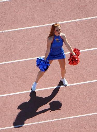 Sep 21, 2013; Lawrence, KS, USA; A Kansas Jayhawks cheerleader performs before the game with the Louisiana Tech Bulldogs at Memorial Stadium. Kansas won 13-10. Mandatory Credit: John Rieger-USA TODAY Sports
