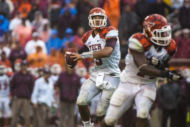 Sep 21, 2013; Blacksburg, VA, USA; Virginia Tech Hokies quarterback Logan Thomas (3) passes the ball against the Marshall Thundering Herd at Lane Stadium. Mandatory Credit: Peter Casey-USA TODAY Sports