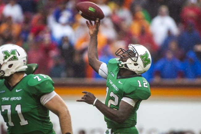 Sep 21, 2013; Blacksburg, VA, USA; Marshall Thundering Herd quarterback Rakeem Cato (12) passes the ball against the Virginia Tech Hokies at Lane Stadium. Mandatory Credit: Peter Casey-USA TODAY Sports