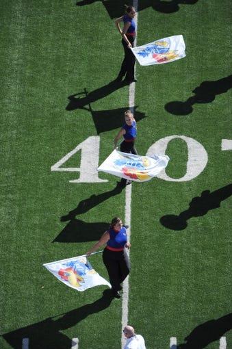 Sep 21, 2013; Lawrence, KS, USA; Members of the Kansas Jayhawks flag team perform before the game with the Louisiana Tech Bulldogs at Memorial Stadium. Kansas won 13-10. Mandatory Credit: John Rieger-USA TODAY Sports