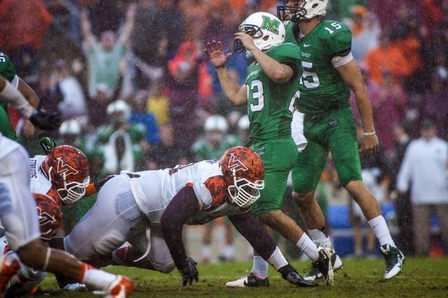 Sep 21, 2013; Blacksburg, VA, USA; Virginia Tech Hokies defensive tackle Derrick Hopkins (98) blocks the field goal attempt by Marshall Thundering Herd kicker Justin Haig (23) during over time at Lane Stadium. Mandatory Credit: Peter Casey-USA TODAY Sports