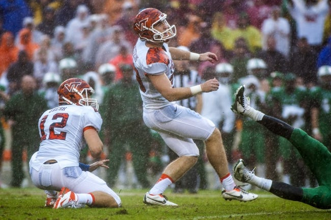 Sep 21, 2013; Blacksburg, VA, USA; Virginia Tech Hokies kicker Ethan Keyserling (29) reacts to missing a field goal during over time against the Marshall Thundering Herd at Lane Stadium. Mandatory Credit: Peter Casey-USA TODAY Sports