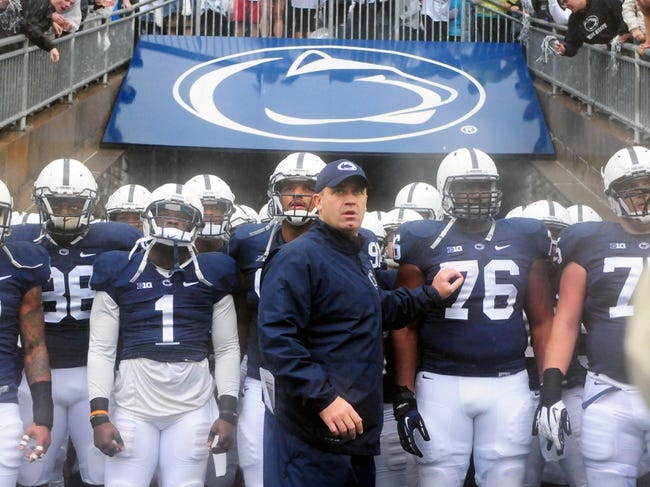 Sep 21, 2013; University Park, PA, USA; Penn State Nittany Lions head coach Bill O'Brien (center) leads his team on to the field prior to the game against the Kent State Golden Flashes at Beaver Stadium. Mandatory Credit: Evan Habeeb-USA TODAY Sports