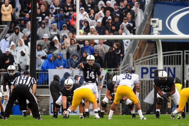 Sep 21, 2013; University Park, PA, USA; Penn State Nittany Lions quarterback Christian Hackenberg (14) changes the call at the line in the first quarter against the Kent State Golden Flashes at Beaver Stadium. Mandatory Credit: Evan Habeeb-USA TODAY Sports