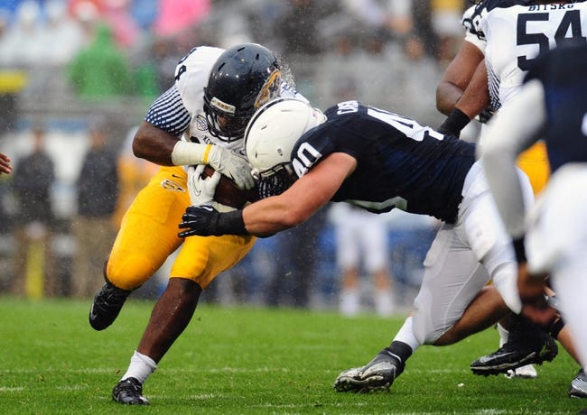 Sep 21, 2013; University Park, PA, USA; Kent State Golden Flashes running back Trayion Durham (34) is tackled by Penn State Nittany Lions linebacker Glenn Carson (40) at Beaver Stadium. Mandatory Credit: Evan Habeeb-USA TODAY Sports