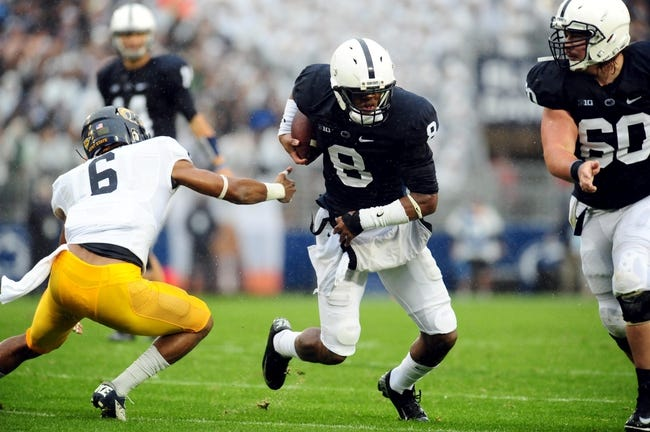 Sep 21, 2013; University Park, PA, USA; Penn State Nittany Lions wide receiver Allen Robinson (8) breaks the tackle of Kent State Golden Flashes safety Keenan Stalls (6) at Beaver Stadium. Mandatory Credit: Evan Habeeb-USA TODAY Sports