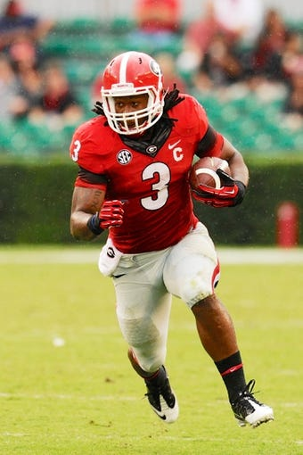 Sep 21, 2013; Athens, GA, USA; Georgia Bulldogs running back Todd Gurley (3) runs against the North Texas Mean Green during the second half at Sanford Stadium. Georgia defeated North Texas 45-21. Mandatory Credit: Dale Zanine-USA TODAY Sports
