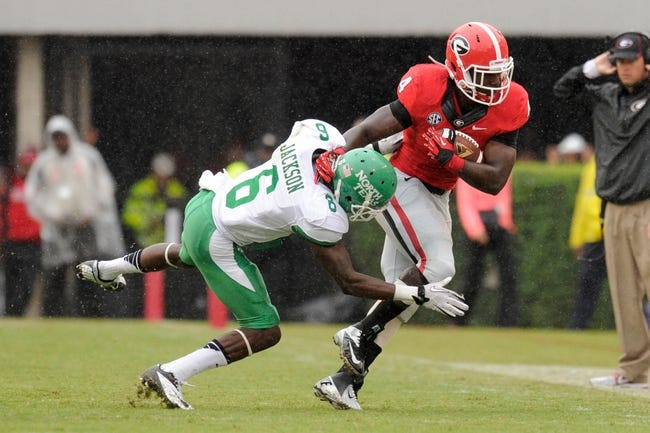 Sep 21, 2013; Athens, GA, USA; Georgia Bulldogs running back Keith Marshall (4) is tackled by North Texas Mean Green defensive back Hilbert Jackson (6) during the second half at Sanford Stadium. Georgia defeated North Texas 45-21. Mandatory Credit: Dale Zanine-USA TODAY Sports