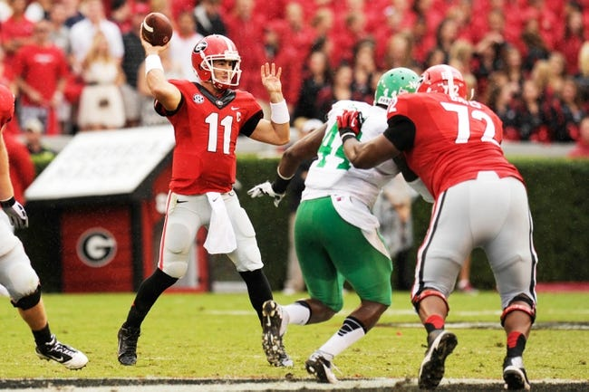 Sep 21, 2013; Athens, GA, USA; Georgia Bulldogs quarterback Aaron Murray (11) passes against the North Texas Mean Green during the second half at Sanford Stadium. Georgia defeated North Texas 45-21. Mandatory Credit: Dale Zanine-USA TODAY Sports
