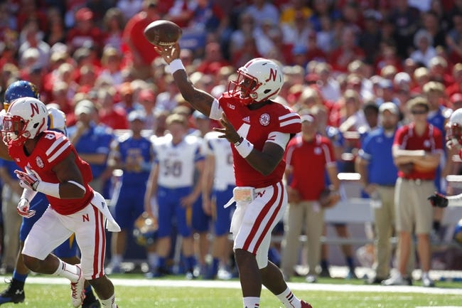 Sep 21, 2013; Lincoln, NE, USA; Nebraska Cornhuskers quarterback Tommy Armstrong Jr throws against the South Dakota State Jackrabbits in the first quarter at Memorial Stadium. Mandatory Credit: Bruce Thorson-USA TODAY Sports