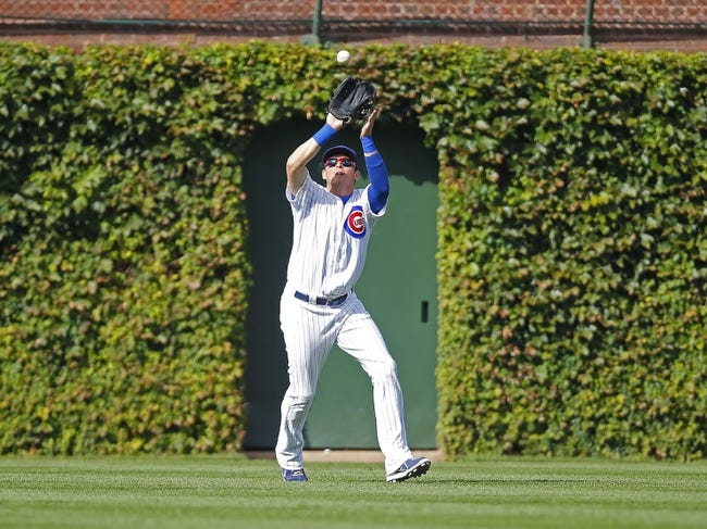 Sep 21, 2013; Chicago, IL, USA; Chicago Cubs center fielder Ryan Sweeney (6) catches a fly ball off the bat of Atlanta Braves catcher Evan Gattis (not pictured) in the second inning at Wrigley Field. Mandatory Credit: Dennis Wierzbicki-USA TODAY Sports