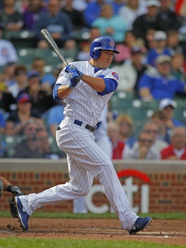 Sep 21, 2013; Chicago, IL, USA; Chicago Cubs left fielder Brian Bogusevic (47) hits a single in the second inning against the Atlanta Braves at Wrigley Field. Mandatory Credit: Dennis Wierzbicki-USA TODAY Sports