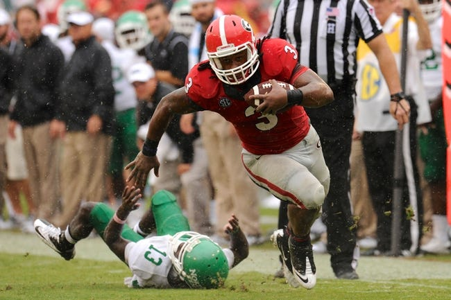 Sep 21, 2013; Athens, GA, USA; Georgia Bulldogs running back Todd Gurley (3) breaks a tackle by North Texas Mean Green defensive back James Jones (13) during the second half at Sanford Stadium. Georgia defeated North Texas 45-21. Mandatory Credit: Dale Zanine-USA TODAY Sports