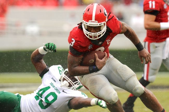 Sep 21, 2013; Athens, GA, USA; Georgia Bulldogs running back Todd Gurley (3) breaks a tackle by North Texas Mean Green defensive end Daryl Mason (49) during the second half at Sanford Stadium. Georgia defeated North Texas 45-21. Mandatory Credit: Dale Zanine-USA TODAY Sports