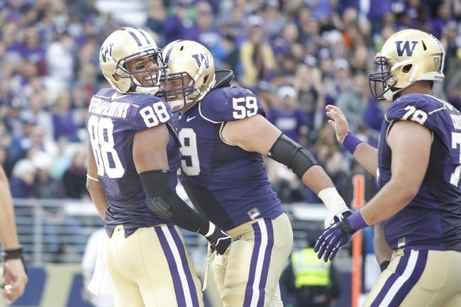 Sep 21, 2013; Seattle, WA, USA; Washington Huskies tight end Austin Seferian-Jenkins (88) celebrates with Washington Huskies right tackle Ben Riva (59) after catching a touchdown pass against the Idaho State Bengals during the second quarter at Husky Stadium. Mandatory Credit: Joe Nicholson-USA TODAY Sports