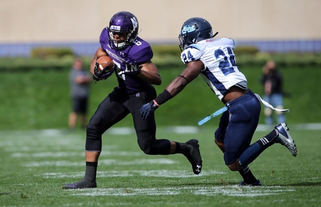 Sep 21, 2013; Evanston, IL, USA; Northwestern Wildcats wide receiver Tony Jones (6) runs past Maine Black Bears defensive back Khari Al-Mateen (24) during the first quarter at Ryan Field.  Mandatory Credit: Jerry Lai-USA TODAY Sports