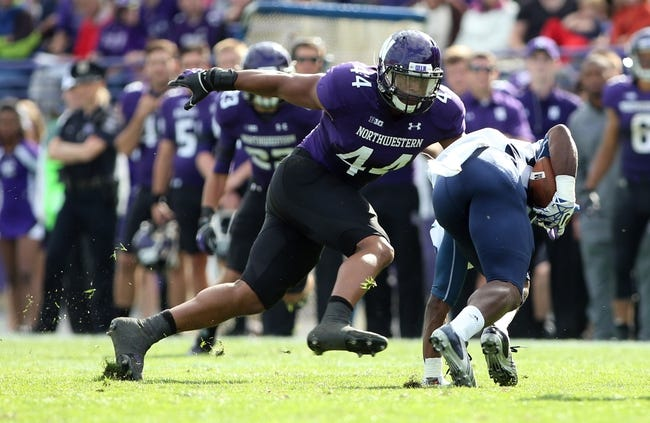 Sep 21, 2013; Evanston, IL, USA; Maine Black Bears wide receiver Damarr Aultman (88) is tackled by Northwestern Wildcats linebacker Chi Chi Ariguzo (44) during the second quarter at Ryan Field.  Mandatory Credit: Jerry Lai-USA TODAY Sports