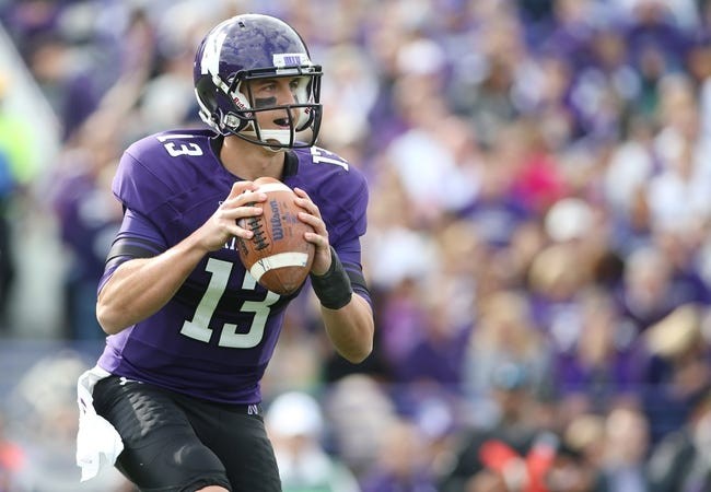 Sep 21, 2013; Evanston, IL, USA; Northwestern Wildcats quarterback Trevor Siemian (13) drops back to pass against the Maine Black Bears during the second quarter at Ryan Field.  Mandatory Credit: Jerry Lai-USA TODAY Sports