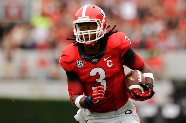 Sep 21, 2013; Athens, GA, USA; Georgia Bulldogs running back Todd Gurley (3) runs the ball against the North Texas Mean Green  during the first half at Sanford Stadium. Georgia defeated North Texas 45-21. Mandatory Credit: Dale Zanine-USA TODAY Sports