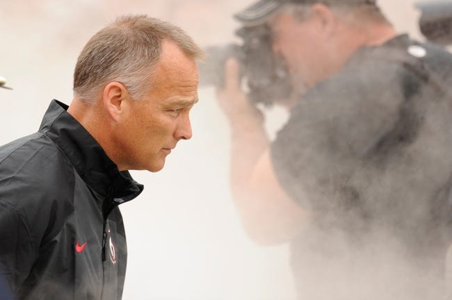 Sep 21, 2013; Athens, GA, USA; Georgia Bulldogs head coach Mark Richt runs out with the team prior to the game against the North Texas Mean Green at Sanford Stadium. Georgia defeated North Texas 45-21. Mandatory Credit: Dale Zanine-USA TODAY Sports