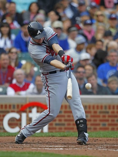 Sep 21, 2013; Chicago, IL, USA; Atlanta Braves third baseman Chris Johnson (23) hits a single in the fourth inning against the Chicago Cubs at Wrigley Field. Mandatory Credit: Dennis Wierzbicki-USA TODAY Sports