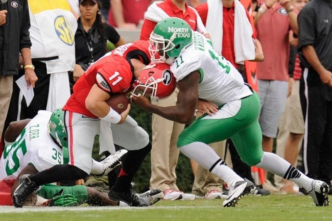 Sep 21, 2013; Athens, GA, USA; Georgia Bulldogs quarterback Aaron Murray (11) is tackled by North Texas Mean Green linebacker Will Wright (11) during the first half at Sanford Stadium. Georgia defeated North Texas 45-21. Mandatory Credit: Dale Zanine-USA TODAY Sports