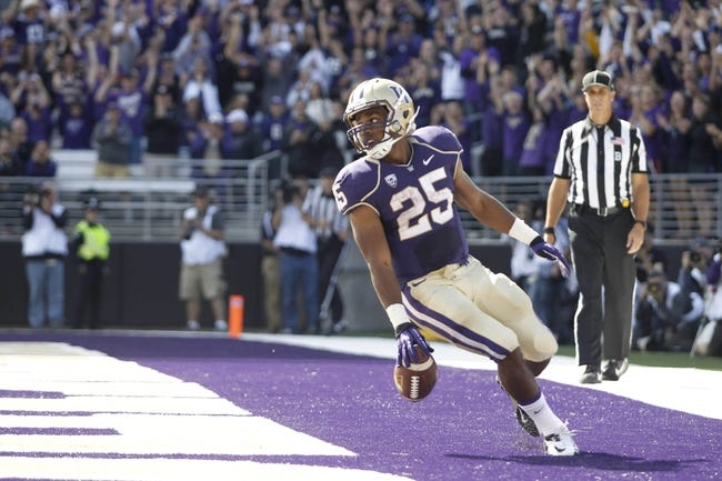 Sep 21, 2013; Seattle, WA, USA; Washington Huskies running back Bishop Sankey (25) scores a touchdown against the Idaho State Bengals during the first quarter at Husky Stadium. Mandatory Credit: Joe Nicholson-USA TODAY Sports