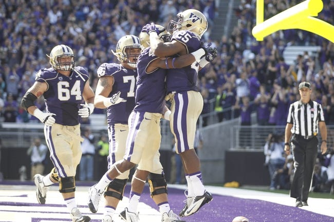 Sep 21, 2013; Seattle, WA, USA; Washington Huskies running back Bishop Sankey (25) celebrates after scoring a touchdown against the Idaho State Bengals during the first quarter at Husky Stadium. Mandatory Credit: Joe Nicholson-USA TODAY Sports