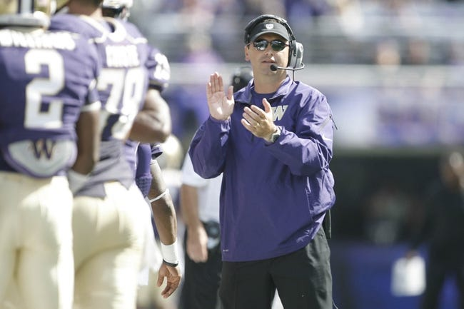 Sep 21, 2013; Seattle, WA, USA; Washington Huskies head coach Steve Sarkisian applauds his team after a touchdown against the Idaho State Bengals during the first quarter at Husky Stadium. Mandatory Credit: Joe Nicholson-USA TODAY Sports