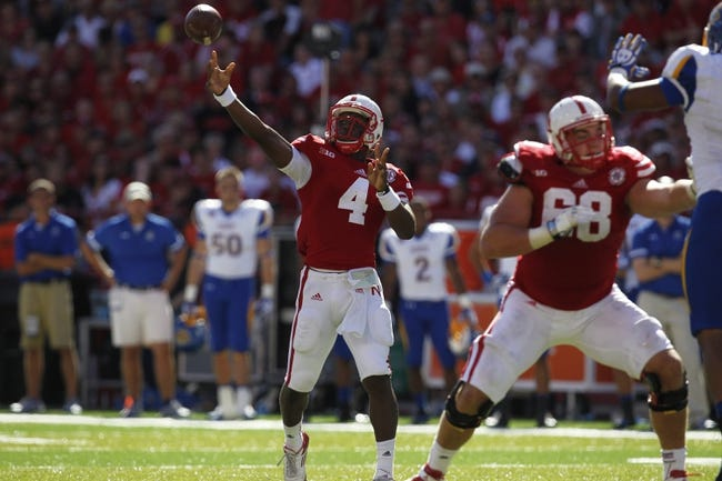 Sep 21, 2013; Lincoln, NE, USA; Nebraska Cornhuskers quarterback Tommy Armstrong Jr throws against the South Dakota State Jackrabbits in the second quarter at Memorial Stadium. Mandatory Credit: Bruce Thorson-USA TODAY Sports