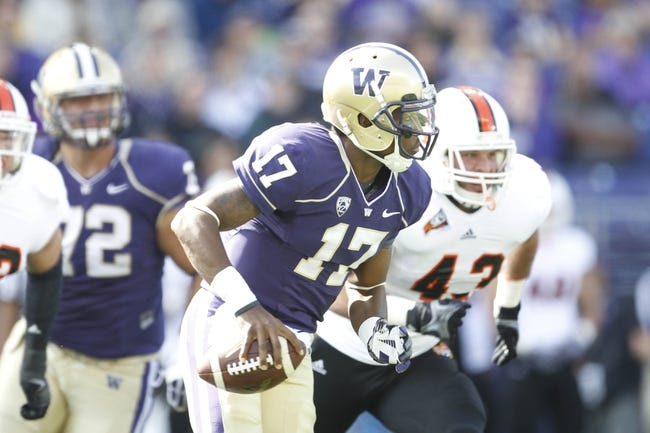 Sep 21, 2013; Seattle, WA, USA; Washington Huskies quarterback Keith Price (17) looks to pass as he scrambles away from pressure against the Idaho State Bengals during the first quarter at Husky Stadium. Mandatory Credit: Joe Nicholson-USA TODAY Sports