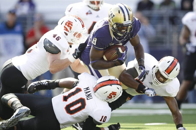 Sep 21, 2013; Seattle, WA, USA; Washington Huskies wide receiver Kevin Smith (8) runs the ball against the Idaho State Bengals during the first quarter at Husky Stadium. Mandatory Credit: Joe Nicholson-USA TODAY Sports