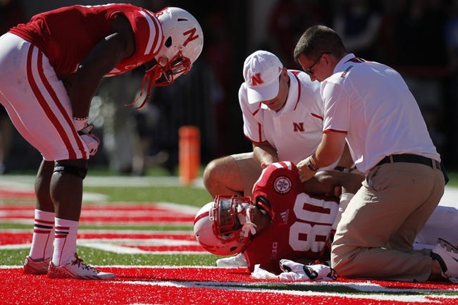 Sep 21, 2013; Lincoln, NE, USA; Nebraska Cornhuskers receiver Kenny Bell (80) is treated on the field during the game against the South Dakota State Jackrabbits in the second quarter at Memorial Stadium. Mandatory Credit: Bruce Thorson-USA TODAY Sports