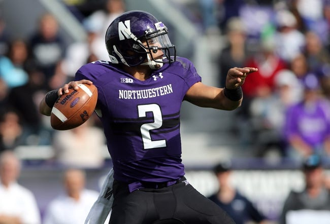 Sep 21, 2013; Evanston, IL, USA; Northwestern Wildcats quarterback Kain Colter (2) throws a pass against the Maine Black Bears during the first quarter at Ryan Field.  Mandatory Credit: Jerry Lai-USA TODAY Sports