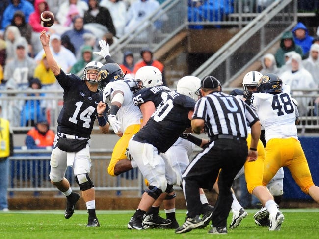 Sep 21, 2013; University Park, PA, USA; Penn State Nittany Lions quarterback Christian Hackenberg (14) throws a pass in the second quarter against the Kent State Golden Flashes at Beaver Stadium. Mandatory Credit: Evan Habeeb-USA TODAY Sports