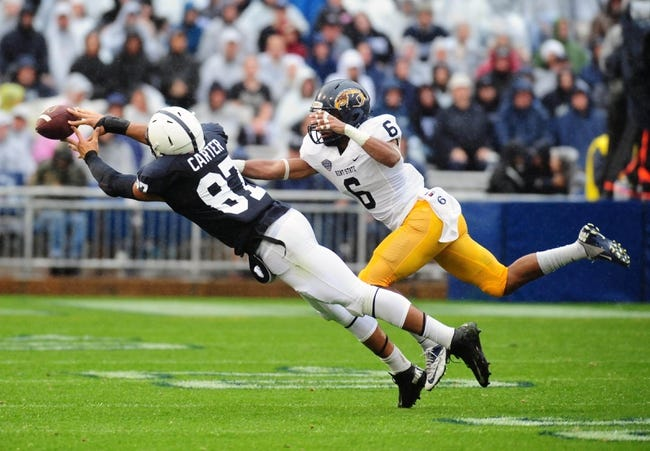 Sep 21, 2013; University Park, PA, USA; Kent State Golden Flashes safety Keenan Stalls (6) defends a pass intended for Penn State Nittany Lions tight end Kyle Carter (87) at Beaver Stadium. Mandatory Credit: Evan Habeeb-USA TODAY Sports